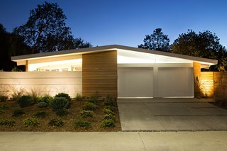 From the street, the home bears many of the typical hallmarks of an Eichler home. Its low roofline is largely supported by glass walls, clear cedar siding provides additional warmth, and the only windows on the front facade are transom windows.