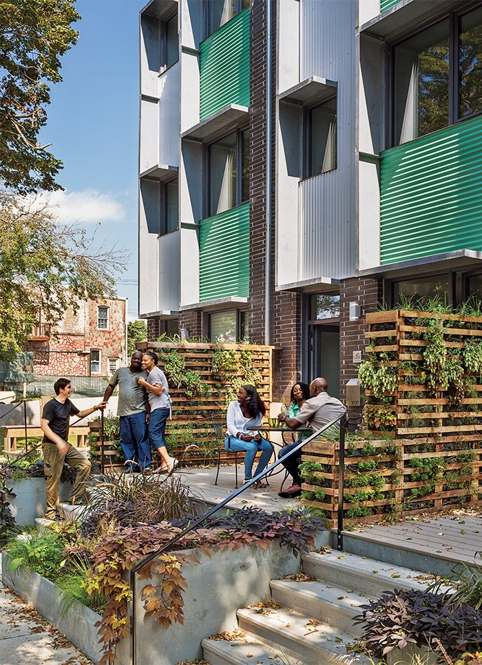 In North Philadelphia, the Belfield Avenue Townhomes were built to Passive House standards, making the project much more energy-efficient than a conventional building. It is one of several multifamily structures that are being built in cities across the country for moderate-income families.  Photo 1 of 3 in Super Green Affordable Housing Introduces Passive Design to the Masses
