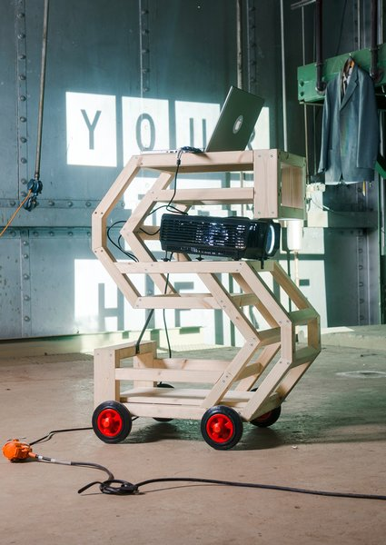 Four prominent designers with different approaches were given a letter to decorate. Marcos Zotes, an Iceland-based Spanish designer, known for doing installations and projects involving urban living, created the 'S'.  He made his letter into a podium and projector stand on wheels that kept popping up as a piece of practical furniture throughout the four days of the event.