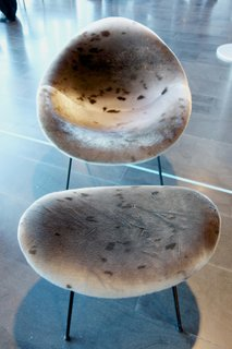 "Ásgeir Einarsson (1927-2001) designed the Sindra chair in 1962. It was re-released last year by G.Á. Húsgögn in a range of different skins for its 50th year anniversary, but the sealskin is new this year. ""The designer had been very strict that the chair be upholstered only in skin, and using only Icelandic materials,"" G.Á. Húsgögn's upholsterer Páll Júníus Valsson said, adding a new puzzle piece to fit into my expanding picture of Iceland's design story. Photo by: Tiffany Orvet"