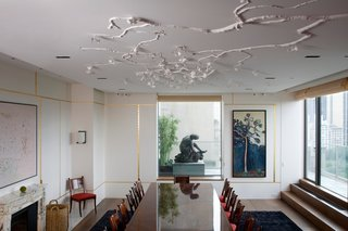 Wiseman created a Gingko installation in this New York residence taking care not to obstruct the client's panoramic views of the city. Structural details within the sculpture help to visually expand the space. Photo by: Sherry Griffin/R 20th Century.