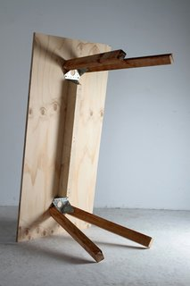 A sturdy dining table requires only two brackets for stability.