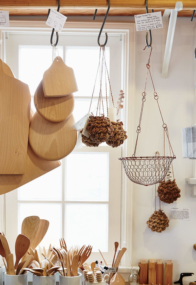A corner of the store holds baskets from F/Style and Kanaami-Tsuji, cutting boards from Etoetoteato, and utensils from Kohchosai Kosuga.  Photo 4 of 6 in A Cute Mom-and-Pop Shop in L.A. Showcases the Latest Japanese Design