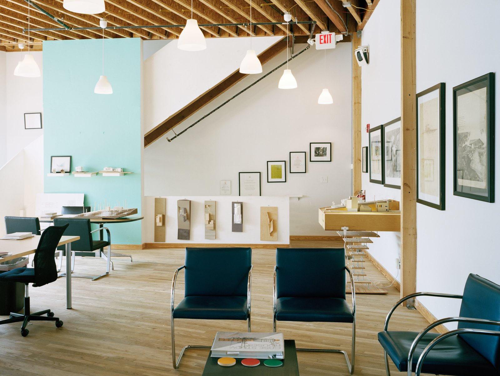 """Living Room, Chair, Coffee Tables, Console Tables, Light Hardwood Floor, Ceiling Lighting, and Pendant Lighting """"A building can have far greater impact than the space it stands in.""""—William Carpenter, architect and resident  Photo 2 of 12 in A Home, Studio, and Gallery Support a Growing Art Scene in Georgia"""