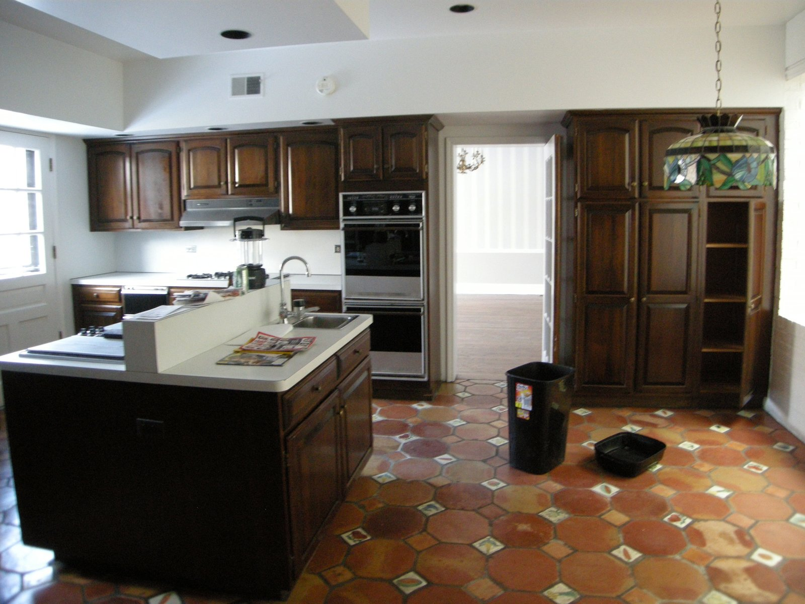 The pre-renovation kitchen.  Photo 6 of 13 in An Impressive 20-Foot Skylight Transforms a Jumbled Chicago Home