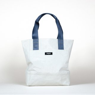 The Nonprofit That's Using Seat Belts and Super Bowl Banners to Fix Up Indianapolis - Photo 2 of 3 - The Archivist tote ($124) by People for Urban Progress is handmade from textiles recycled from Indianapolis infrastructure, including the roofing fabric of the RCA Dome.