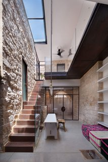 Irit and Zohar imagined a space that would be a cohesive blend of old and new. Stone, metal, glass, and wood intersect in the interior courtyard. Large skylights bring light in, and play upon the indoor-outdoor functionality of the courtyard space.