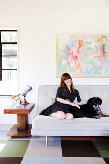 """45 Pets in Beautiful Modern Homes - Photo 23 of 45 - Allison says the living room, which receives loads of natural light, is her favorite space in the house. """"I love sitting on the sofa and looking out the window,"""" she says. """"It is a really special room and we hang out in there 90 percent of the time."""""""