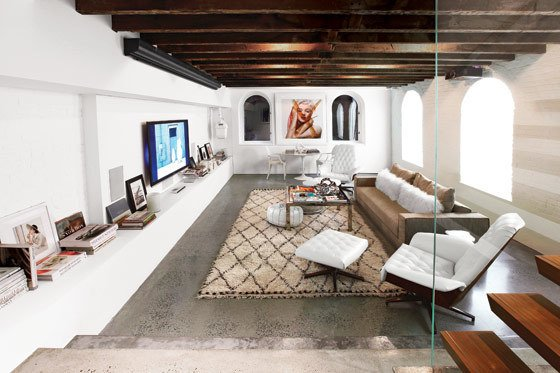 "New York interior designer Betsy Morgan included a pair of George Mulhauser for Plycraft lounge chairs, upholstered in white leather, in a Chelsea basement-turned-rec-room with a ""relaxed, Moroccan vacation vibe."" Photo by Costas Picadas via New York Magazine.  Photo 3 of 6 in Mr. Chair by George Mulhauser for Plycraft"