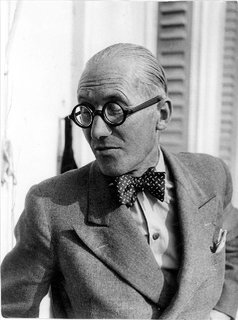 Architects weren't the only professionals to favor bow ties—surgeons, printers, and anyone else who didn't need a necktie flapping around as he worked wore them. But Corbu's bow gives his peak lapels and pocket square a bit of elan you rarely found on country doctors.