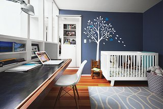 The office, which is also Lily's room, features a Babyletto crib and a Smileywalls wall decal applied atop Normandy paint from Benjamin Moore.