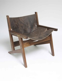 Part of the appeal of the Peninsula chair is that the sling is attached using just brass rods. Should you even want to change the sling, merely slide them out and do so.