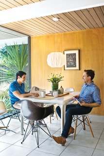 The couple's vintage Stadio dining table is by Vico Magistretti for Artemide; the Eames chairs came from an old school in Palm Springs.