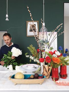 Ever the arranger, Aumas makes another vignette in the kitchen amid vintage vases and bowls.