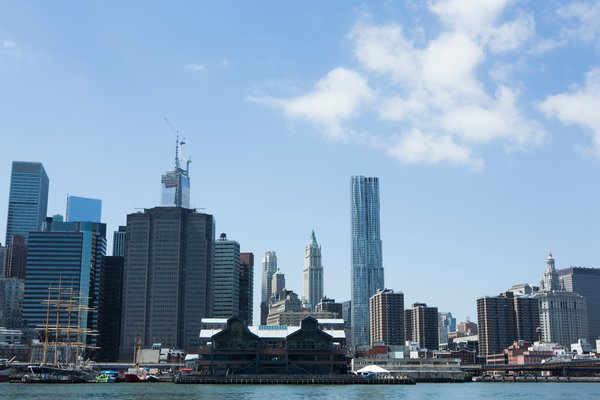 Around Manhattan Architectural Boat Tours by AIA New York - Photo 4 of 13 - Cass Gilbert's Woolworth Building stands in the distance behind Frank Gehry's 8 Spruce Street (which will hold the post as tallest residential tower in the Western Hemisphere until One57's completion uptown).