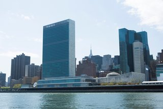 The United Nations makes a strong riverside presence. In the foreground, the UN Headquarters built with contributions by Wallace K. Harrison, Le Corbusier, Oscar Niemeyer, and Sven Markelius. Behind and to the right of the campus, the UN Plaza Offices and Hotel by Roche Dinkeloo.