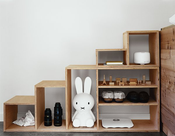 The built-in storage holds 30 pairs of Kiyoko's shoes.  Photo 6 of 11 in Abandoned Industrial Compound Becomes a Modern Home Base