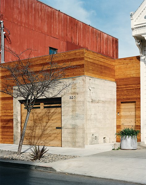 Exterior and Wood Siding Material The front entrance is located next to the garage.  Photo 8 of 11 in Abandoned Industrial Compound Becomes a Modern Home Base