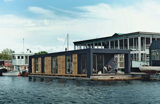 A couple that just couldn't bear to live on terra firma reside in this floating home in Copenhagen.
