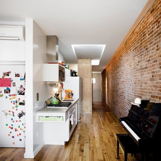 Living small is par for the course in New York City, but accommodating a family of four in under 700-square-feet rarely looks as effortless as in this storage-smart renovation. Scott Oliver and Margarita McGrath of Noroof Architects created many clever built-ins and transformable furniture in this apartment.