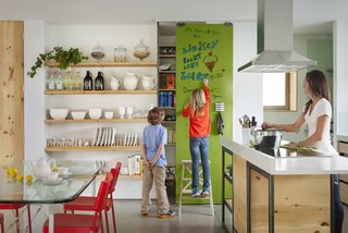 An IdeaPaint wall is in full-effect in this family's kitchen.