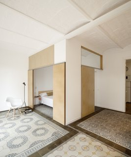 12 Creative Ways to Use Tile in Your Home - Photo 3 of 12 - This renovated apartment in Barcelona plays with subtle color contrasts, such as the chromatic tile mosaics and the blond wood used for sliding doors and benches.