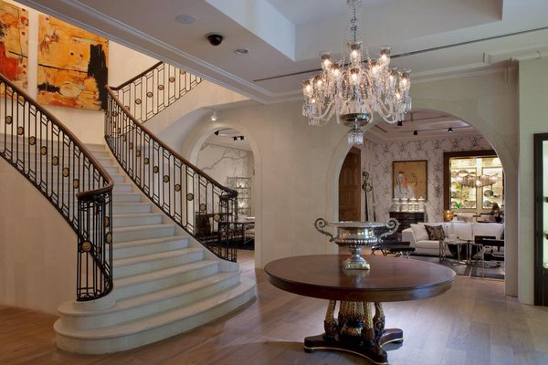 The mansion entry hall includes a large staircase that allows the customer to meander through multiple floors.