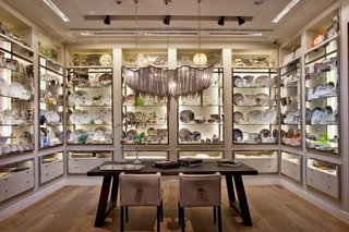 Casa Palacio: A New Retail Concept Store in Mexico City - Photo 8 of 9 - The tableware collections are showcased in a modern interpretation of a classic butler's pantry with indirect lighting and polished stainless steel frames.