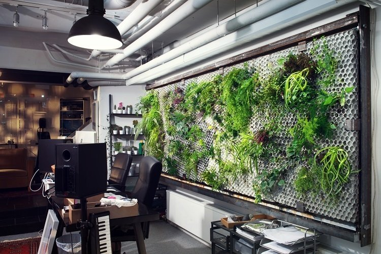 Studioverket (Stockholm, Sweden)  This former strip club got a hip renovation by designers Per & Toki, featuring air bubble-patterned concrete walls and hanging gardens. The dark and shady entrance now leads to a light-infused workspace and music studio.  Photo 12 of 13 in 13 Inspiring Coworking Spaces