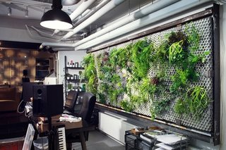 Studioverket (Stockholm, Sweden)<br><br>This former strip club got a hip renovation by designers Per & Toki, featuring air bubble-patterned concrete walls and hanging gardens. The dark and shady entrance now leads to a light-infused workspace and music studio.