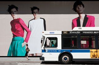 New York City ad and passing bus.