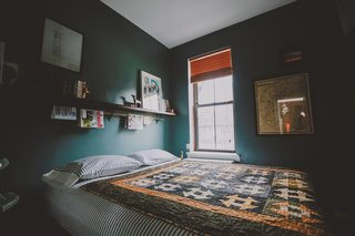 A bedroom is the best place to be moody. Use a saturated color (put down the off-white!) and a satin finish (preserves the light) on the walls—we promise you won't regret it. Photo by Chellise Michael Photography.