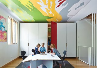 The ceilings in the children's rooms and playroom feature abstract details from Thomas Hart Benton paintings. Hufft Projects designed the marker-board table, which was cut in the shape of the state of Missouri.