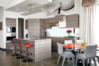 Cranston collaborated with project designer John A. Turturro and builder Bryan Henson of Allen Associates on the 2,400-square-foot house. The architect of record is Larry Graves of Alliance Design Group. Eco-conscious materials were key: In the kitchen, Poggenpohl cabinets were chosen for their recycled wood content and for the company's low-waste factory efficiency. The Sub-Zero Wolf refrigerator uses less energy than a 100-watt light bulb.<br><br>Roche Bobois Ublo barstools pull up to the kitchen island; a Reduced fixture from Louis Poulsen hangs above. The dining area features a Lunch Time dining table and Chabada chairs, also from Roche Bobois.<br><br>To learn more about the Cranston Residence project and its players, please visit www.3palmsproject.com