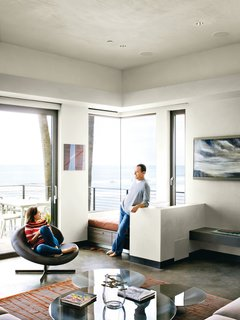 Bryan and Robin relax in a corner of the living room; the custom rug is from the Rug Affair.<br>
