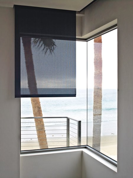Without some type of shading device, traditional windows—especially those that look out onto reflective surfaces like bodies of water or mountains covered with snow—can create glare on the interior of a room.