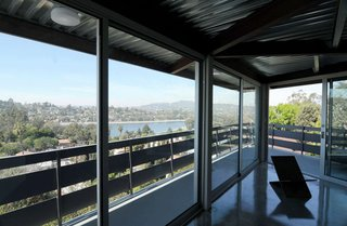 Located at the top of a hill, the house rises above the Silver Lake Reservoir, which can be seen from the living room upstairs.