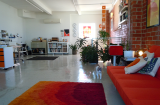 The top floor of the space is reserved for Colorola Studios, Patterson's graphic design firm.