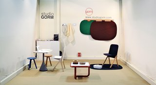 Studio GormMinimalist plastic-and-wood Judd coffee table and Scene carpet, whose abstract shapes recall American highway landscapes seen from a car window.