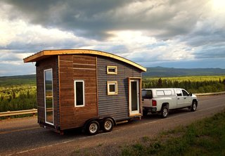 The Leaf House is a lightweight, mobile trailer that was carefully engineered to weigh less than 5,000 pounds. The designer, Laird Herbert, used a metal-mesh, open-joint rain screen as the cladding on the front end, and spruce pine on the back.