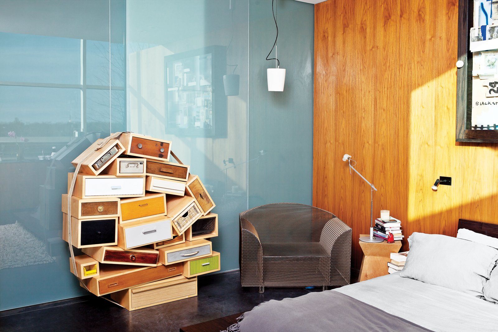 Bedroom, Bed, and Storage The master bedroom features a Chest of Drawers by Tejo Remy for Droog and a How High the Moon chair by Shiro Kuramata.  Photo 5 of 10 in An Architect References Local Architecture to Build a Modern Home
