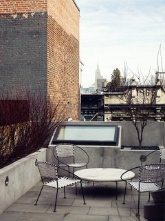 Skylights are visible—and easily reached for cleaning—from this rooftop terrace in New York.