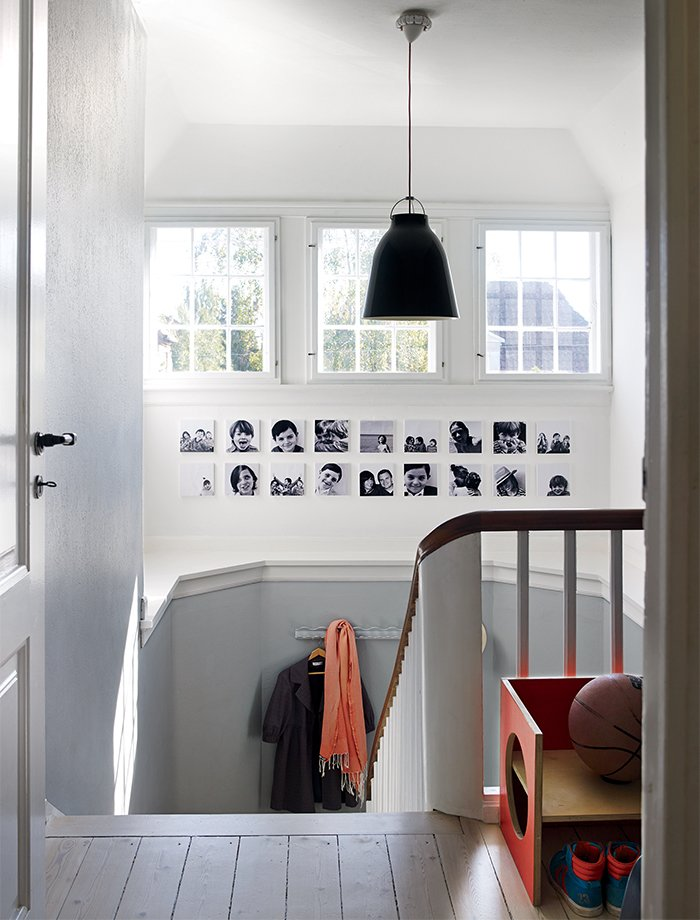 Staircase, Wood Railing, and Wood Tread In the Denmark home of designer Eglantine Charrier, original 1920s windows and moldings meet modern accessories like a black Caravaggio pendant lamp by Cecilie Manz for Lightyears.  Photo 1 of 12 in A Cramped Attic Became a Sunny Dining Room in this Renovation of a Copenhagen Tudor
