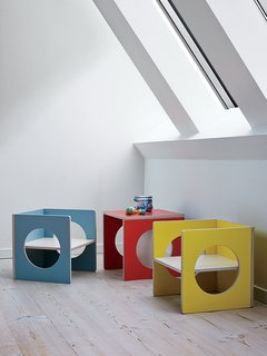 A Cramped Attic Became a Sunny Dining Room in this Renovation of a Copenhagen Tudor - Photo 4 of 12 - The house is filled with pieces from Small-Design, the children's furniture company cofounded by Charrier, including the transformable Cube, which does double duty as a chair or table in the top floor kitchen-dining area.