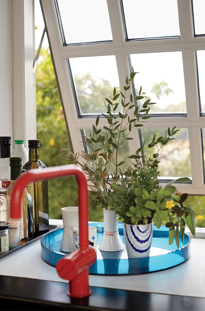 A red Vola faucet adds color, while the muntin bars on the windows recall the originals.  Photo 7 of 12 in A Cramped Attic Became a Sunny Dining Room in this Renovation of a Copenhagen Tudor