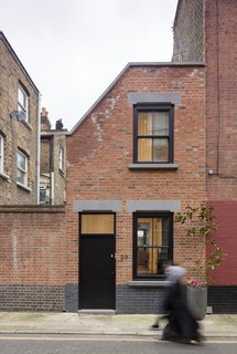 Set in a conservation area, the home's façade was designed to blend into the street's terrace style. To that end, it is clad in red bricks from Traditional Brick & Stone and punctuated with sash windows. The concrete toned lintels hint subtly at the modernity that lies within.
