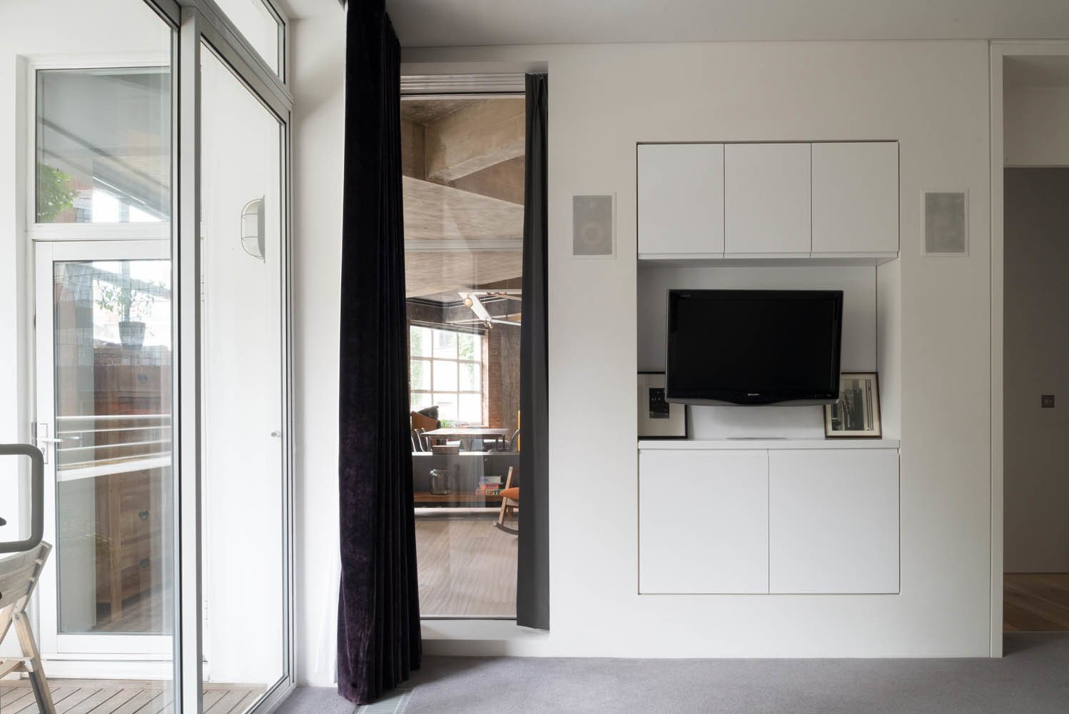 A view of the living room through a floor-to-ceiling window in the bedroom. Photo by Jim Stephenson.  Photo 7 of 8 in Renovation Opens Up a London Apartment