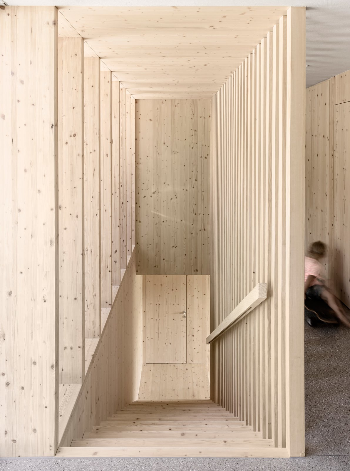 An unadorned spruce wood staircase leads to the upper level.  Photo 6 of 10 in A Simple Gabled House Features an Intricate Latticework Shell from House For Julia Björn