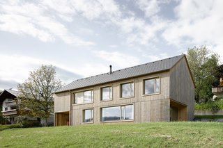 The house's simple gable form helps the house blend in with its neighbors.
