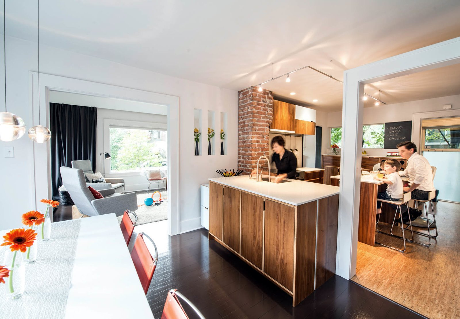 Architects Sara and Jeremy Imhoff and their son Jonah use the renovated kitchen in their 1918 bungalow in Seattle's Fremont neighborhood.  Photo 1 of 7 in Transformative House Renovation in Seattle